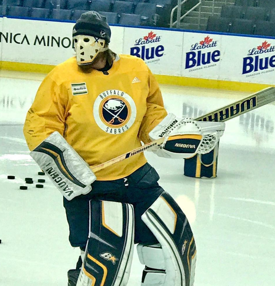 b401b207 ... gold and cobalt striping on each side with the throwback-style Buffalo  logos across the top.